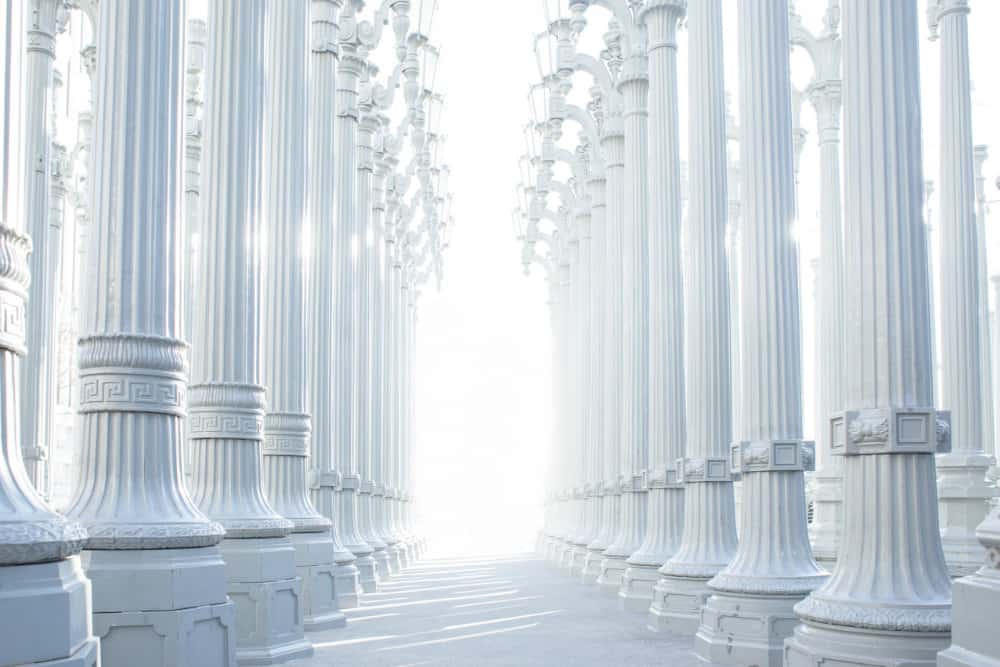 Bright white decorative image of large white columns in a line